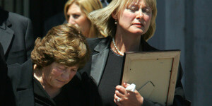 The widow and mother of Michael Erceg at his funeral.
